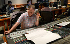 Scoring consultant David Connor looks over a cue
