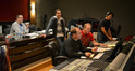 Composer Christopher Lennertz, music editor Todd Bozung, digital score recordist Kevin Globerman, scoring mixer Jeff Vaughn, and second engineer Keith Ukrisna