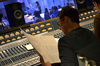 Composer Frederik Wiedmann examines a cue