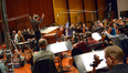Conductor Nick Glennie-Smith and the orchestra prepare to record