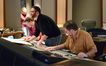 Supervising orchestrator Stephen Coleman, composer Matthew Margeson, and score recordist Frank Wolf listen as a cue is recorded for <i>Kick-Ass</i>