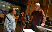 Orchestra contractor Peter Rotter talks with conductor Nick Glennie-Smith