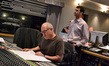 Scoring mixer Dennis Sands and composer Ramin Djawadi listen back to the mix