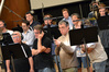 The men of the choir prepare to record