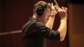 Composer Brian Tyler conducts his score to <i>Teenage Mutant Ninja Turtles</i>