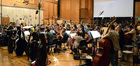 Conductor Nick Glennie-Smith and the orchestra