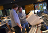 Composer Henry Jackman shows lead orchestrator Stephen Coleman an edit