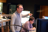 Composer Henry Jackman gives feedback after watching the playback