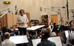 Conductor Nick Glennie-Smith talks to the cello section
