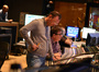 Composer Henry Jackman listens carefully to the mix with scoring mixer Alan Meyerson and stage recordist Tim Lauber