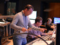 Composer Henry Jackman conducts a cue behind the scenes as scoring mixer Alan Meyerson and stage recordist Tim Lauber follow along