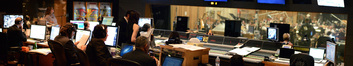 The booth watches conductor/orchestrator Tim Simonec and the orchestra record a cue from <i>Dawn of the Planet of the Apes</i>