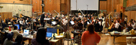Conductor/orchestrator Tim Simonec and the orchestra perform on <i>Dawn of the Planet of the Apes</i>