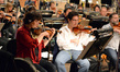 Concertmaster Belinda Broughton with violinist Darius Campo