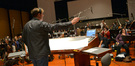 Composer and conductor Timothy Williams records with the orchestra