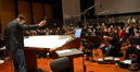 Composer and conductor Timothy Williams and the orchestra prepare to record
