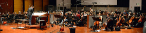 Composer Timothy Williams and the orchestra record the score for the <i>The Wizarding World of Harry Potter</i> theme park attraction