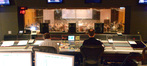 The view from the booth of composer Christopher Lennertz conducting the orchestra on <i>Horrible Bosses 2</i>