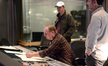 Director Seth MacFarlane and scoring mixer Richard Breen look on as composer Joel McNeely edits a cue