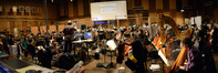 Composer and conductor Joel McNeely records with the orchestra
