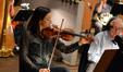 Violinist Serena McKinney tunes her instrument