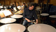 Percussionist Greg Goodall tunes the timpani