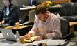 Score technical assistant Erick DeVore makes notes