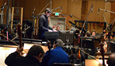 Conductor Tim Davies and the string section of the Angel City Studio Orchestra