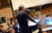 Conductor Tim Davies prepares to record