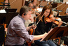 Violinist Mark Robertson makes edits to his part