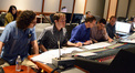 Orchestrator Michael Lloyd, scoring coordinator Alex Bornstein, orchestrator Andrew Kinney, score coordinator Drew Silverstein, and scoring mixer Jeff Vaughn