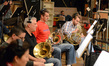 The French horns wait between cues: Jenny Kim, Dan Kelley, Dave Everson, Steve Becknell, Andrew Bain, and Jim Thatcher (obscured)