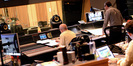 Scoring mixer Brad Haehnel and composer John Powell look on as a cue from <i>Rio 2</i> is recorded