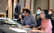 Composer Michael Giacchino and scoring mixer Joel Iwataki watch the playback