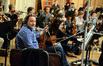 The violins prepare to record the next cue