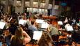 Composer Tom Holkenborg thanks the orchestra