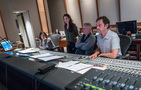 Scoring assistant Raashi Kulkarni, composers Sherri Chung and Blake Neely, and scoring mixer Greg Hayes listen to the mix