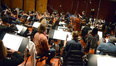 Composer Brian Tyler and the orchestra record a cue