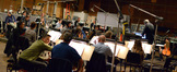 Conductor Michael Kosarin and the orchestra get ready for the next cue