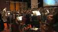 Conductor/orchestrator Nicholas Dodd and the orchestra perform on <i>The Good Dinosaur</i>