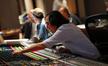 Scoring mixer Joel Iwataki adjusts levels