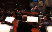 Composer Michael Giacchino and conductor/orchestra Tim Simonec make edits on the podium
