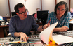 Composer Michael Giacchino and scoring mixer Joel Iwataki review a cue together
