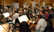 The orchestra warms up before the session
