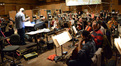 Orchestrator Tim Simonec conducts the orchestra on <i>Jurassic World</i>