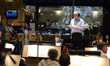 Conductor and orchestrator Tim Simonec relays feedback from the booth to the orchestra