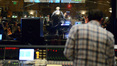 Composer Michael Giacchino watches as the orchestra records his score under the baton of orchestrator Tim Simonec