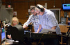 Composer Michael Giacchino makes edits with vocal contractor Bobbi Page and conductor and orchestrator Tim Simonec