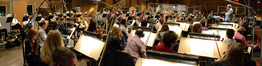 Orchestrator and conductor Tim Simonec with the orchestra on <i>Jurassic World</i>
