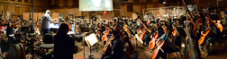 Orchestrator Tim Simonec and the orchestra record composer Michael Giacchino's score to <i>Jurassic World</i>